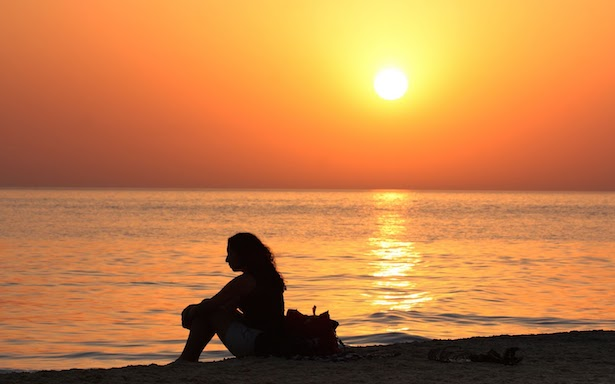 woman_sitting_on_the_beach_at_sunset-other