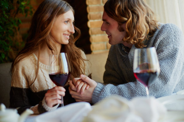 Portrait of amorous young couple spending time in restaurant