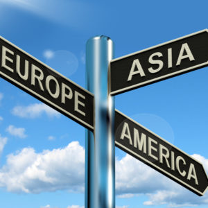 Europe Asia America Signpost Shows Continents For Travel Or Tourism