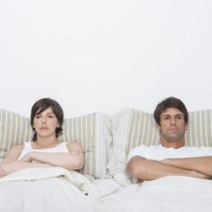 Hispanic couple in bed