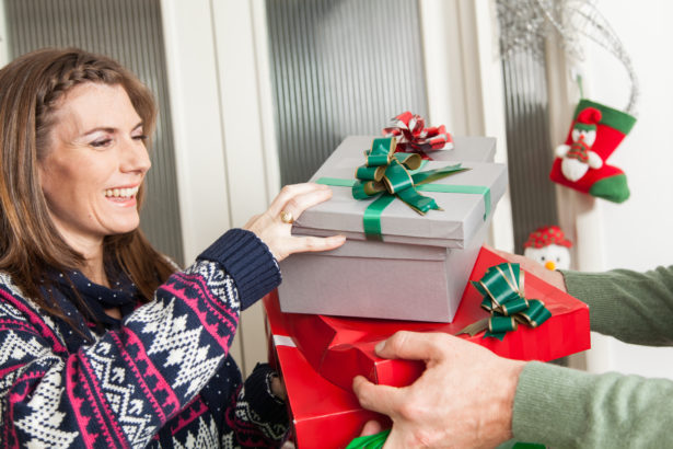 Man giving a gifts to a woman